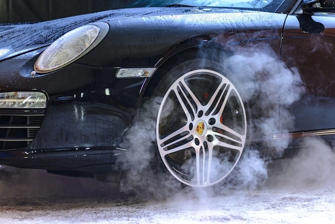 Smoke brakes warning signs from a Porsche