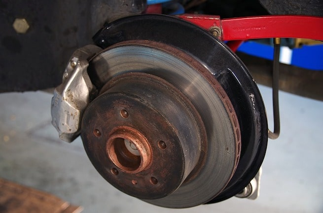 No tires and just the braking system ready for brake pad replacement