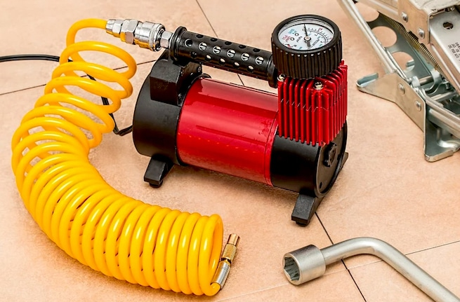 Auto air compressor in garage for car tires