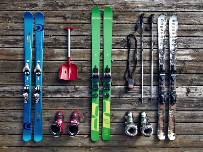 Ski equipment with boots and ski poles perfect to fit on a ski rack