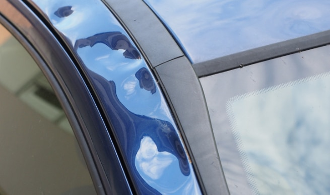 Hail damage on side door could devalue your car or vehicle significantly