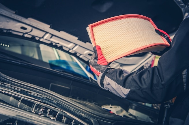 Vehicle air filter replacement by mechanic